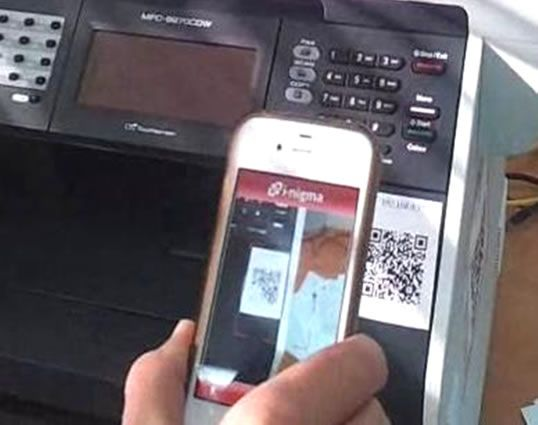QR code attached to a printer, viewed on a mobile device.
